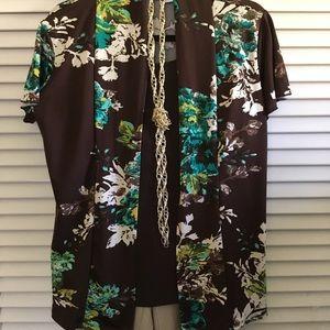 Brown pleasing print flutter sleeved blouse.